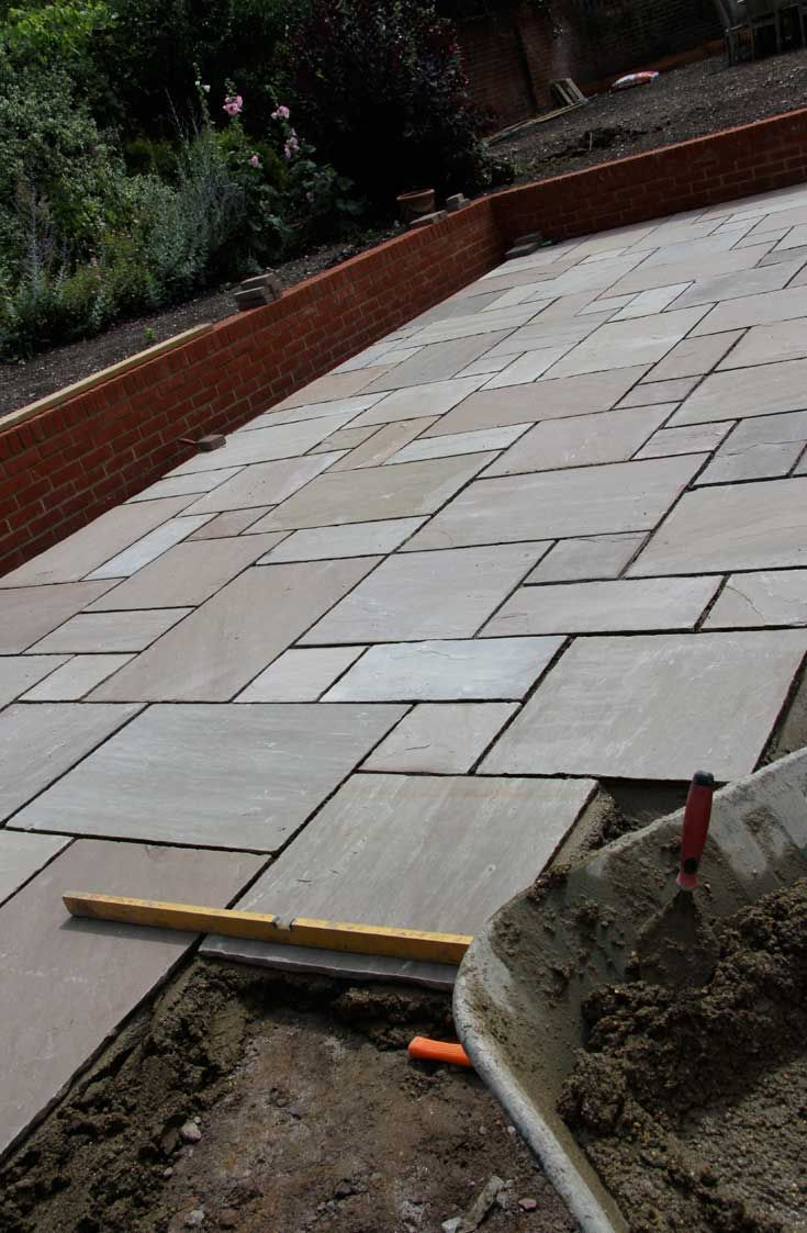 Raj Green sandstone slabs.  http://www.dtstone.co.uk/raj-green-sandstone-patio-paving-slabs.html