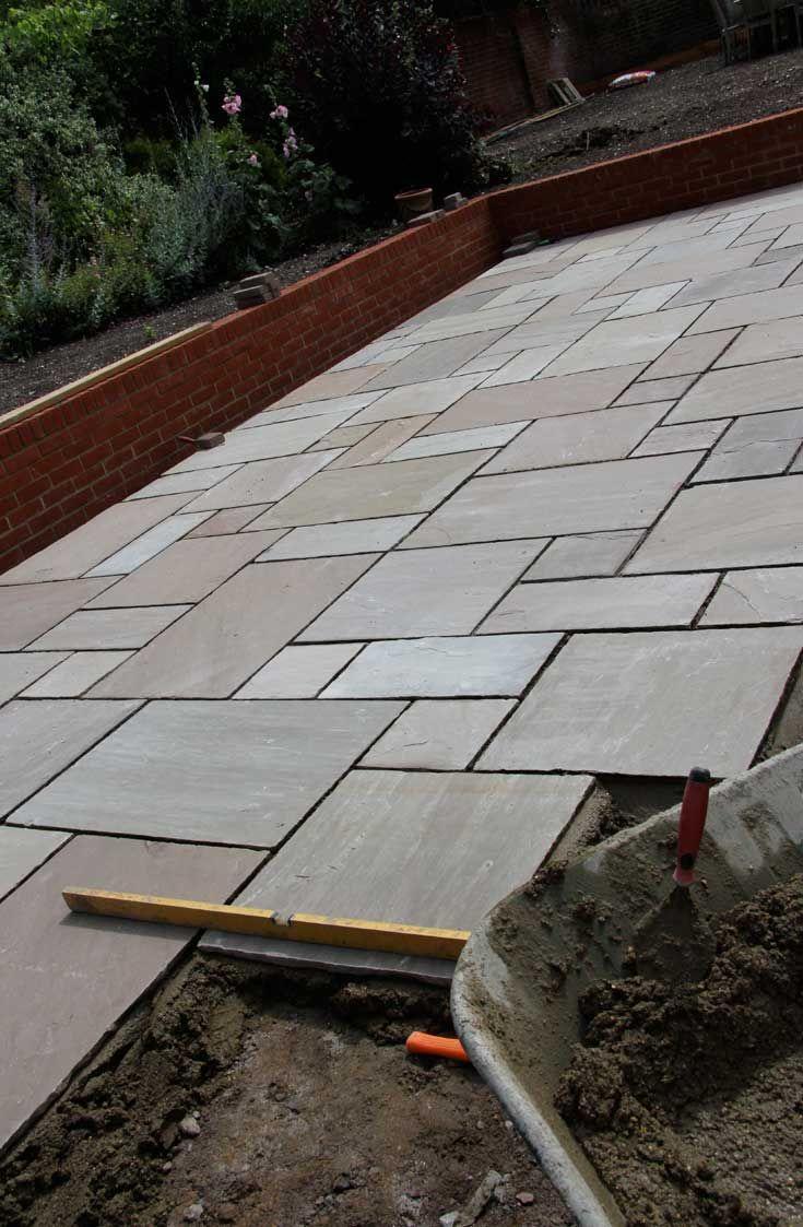 Raj Green sandstone slabs.  http://www.dtstone.co.uk/raj-green-sandstone-patio-paving-slabs.html