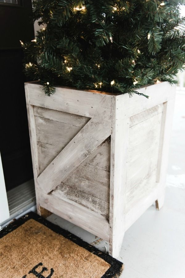 DIY Porch Planters from Craftsman Drive fit right in with a Christmas by throwing smaller Christmas Trees in them, framing the front door!!!