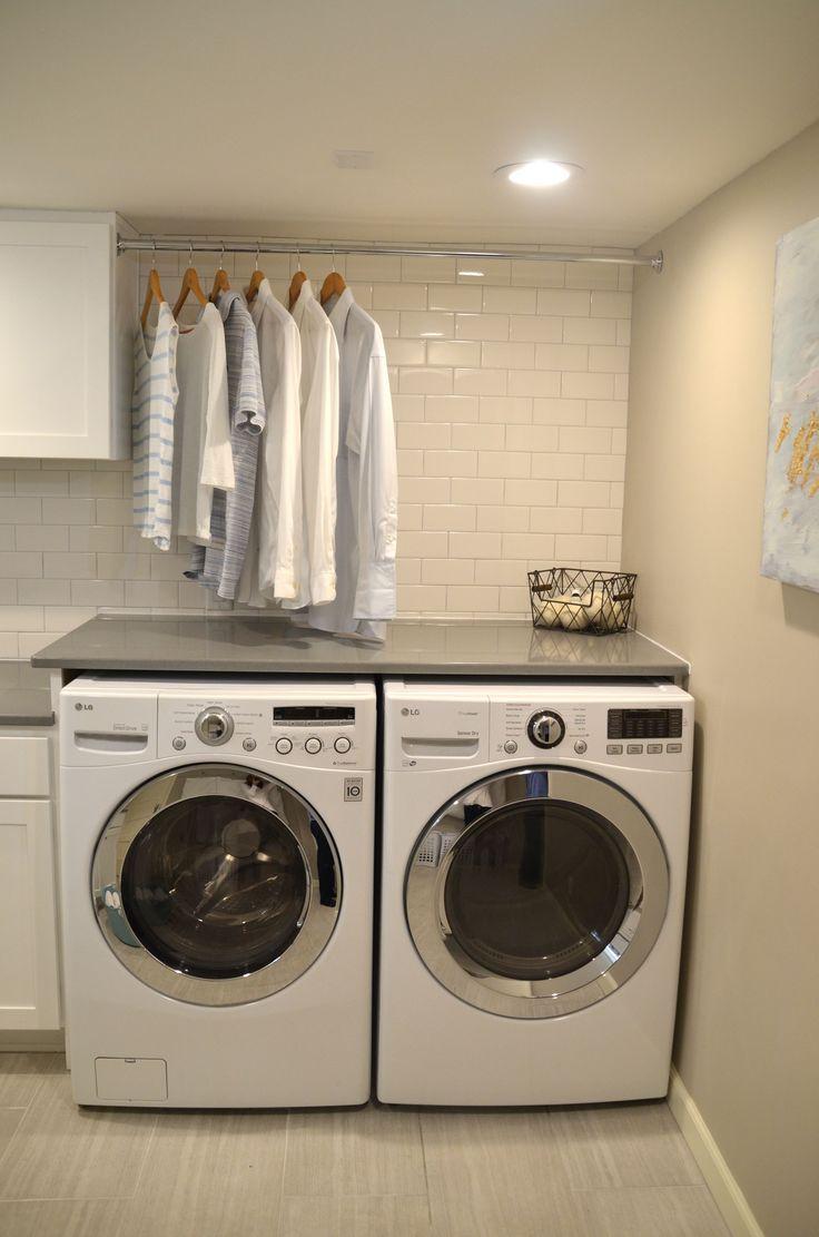 Neat Little Nest: Organized Laundry Room. #Organized #White #SubwayTile #Hanging Clothes #White