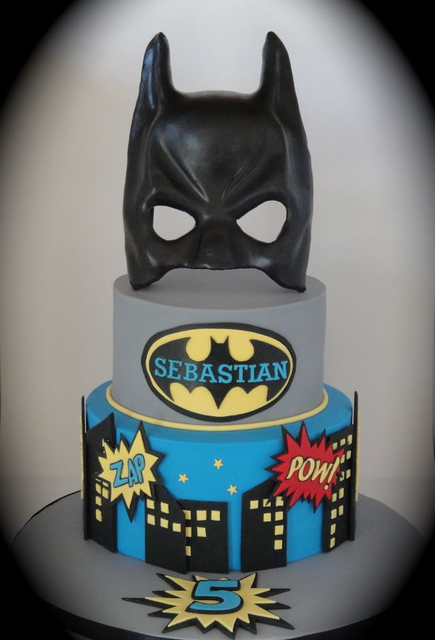 Made for my sweet nephew on his 5th birthday! 7 inch and 9 inch round dark chocolate mud cake with chocolate ganache. All decorations made from fondant and the mask is made from gum paste. Thank you to Anne-maries cakes for inspiration!