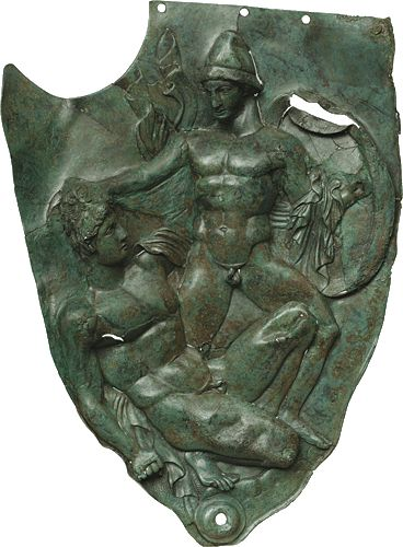Cheek piece of a bronze helmet showing warriors engaged in a battle, from the sanctuary of Zeus at Dodona, 400 B.C. National archeological museum Athen