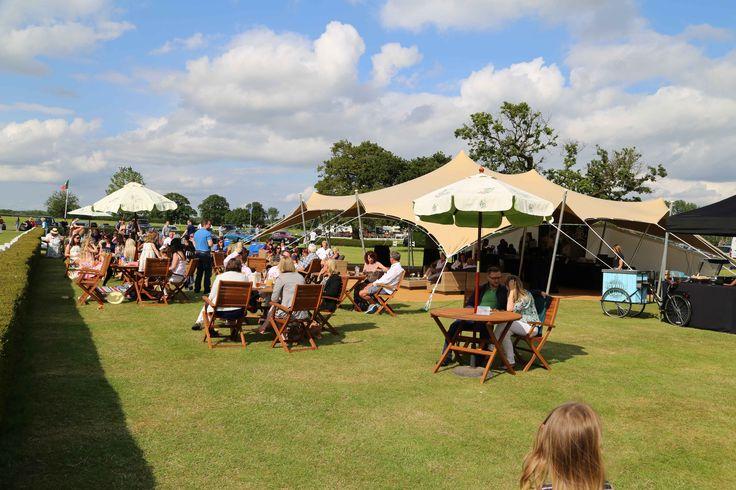 A bar Stretch Tent from Freestretch.co.uk #stretchtent #alternativemarquee #event #weddingvenue #eleganttent #moderntent #modernmarquee #barmarquee #tent #festivalwedding