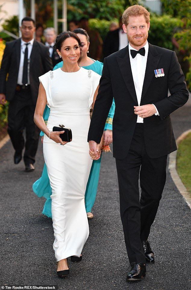 ac76ec746b655 Meghan's most expensive outfit came early in her pregnancy, during the  royal's trip to Ton.