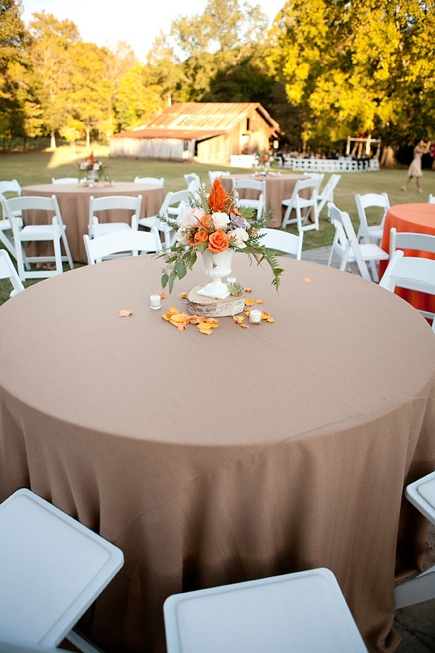 Organically-styled fall wedding centerpieces with succulents, orange, and white flowers