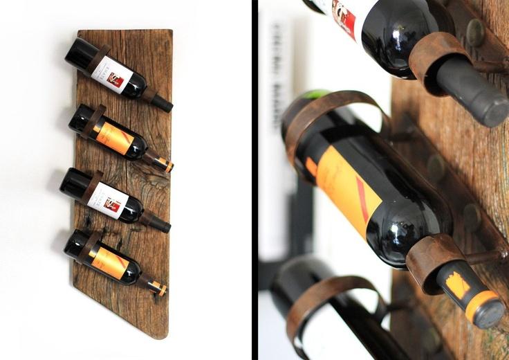 Botellero artesanal realizado en madera antigua y hierro acabado en óxido.. €120,00, via Etsy.
