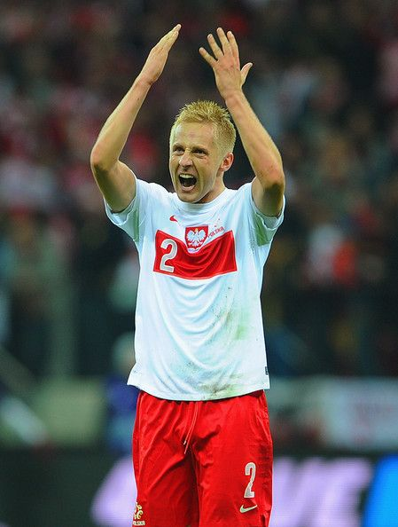 Kamil Glik of Poland celebrates scoring to make it 1-1 during the FIFA 2014 World Cup Qualifier between Poland and England at the National Stadium on October 17, 2012 in Warsaw, Poland. - Poland v England - FIFA 2014 World Cup Qualifier