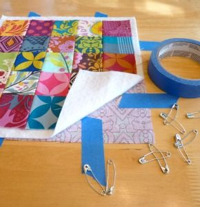 quilting tips from a pro! I must remember the painters tape to hold the back fabric down. Very useful