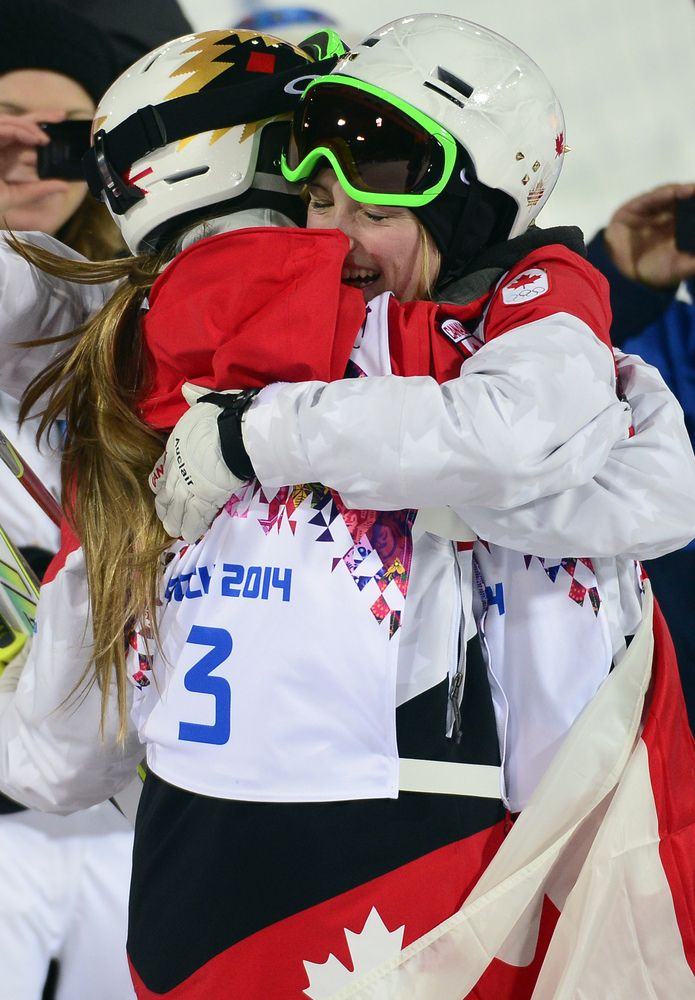 Bronze Medallist, Canada's Chloe Dufour-Lapointe (3) hug her sister Canada's Justine Dufour-Lapointe who won Gold in the Women's Freestyle Skiing Moguls finals at the Rosa Khutor Extreme Park during the Sochi Winter Olympics on February 8, 2014. AFP PHOTO / JAVIER SORIANO (Photo credit should read JAVIER SORIANO/AFP/Getty Images)