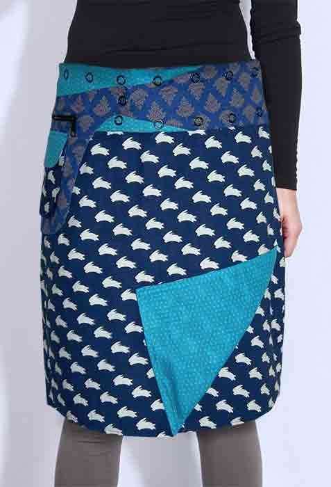 Knee length reversible wrap skirt with press stud waistband and removable feature pocket.