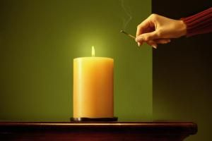 lighting a candle - Stephen Swintek/Stone/Getty Images