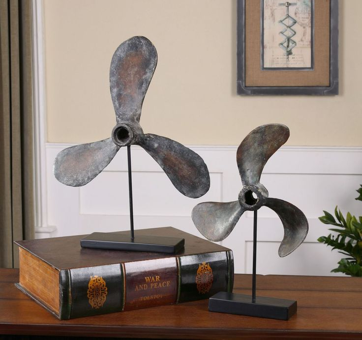 A set of 2, these interesting nautical rustic sculptures of vintage boat propellers mounted on iron stands would be conversation pieces at your coastal home! Each piece features a rust brown finish wi