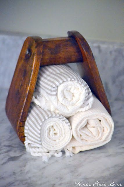 Old wooden horse stirrup for extra towels in powder room