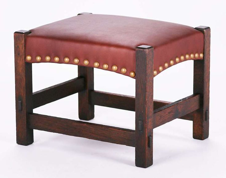 3013. Gustav Stickley #300 footstool with arched seat c1905.  Unsigned.  Original finish.  20.25″w x 16.5″d x 15.5″h SOLD