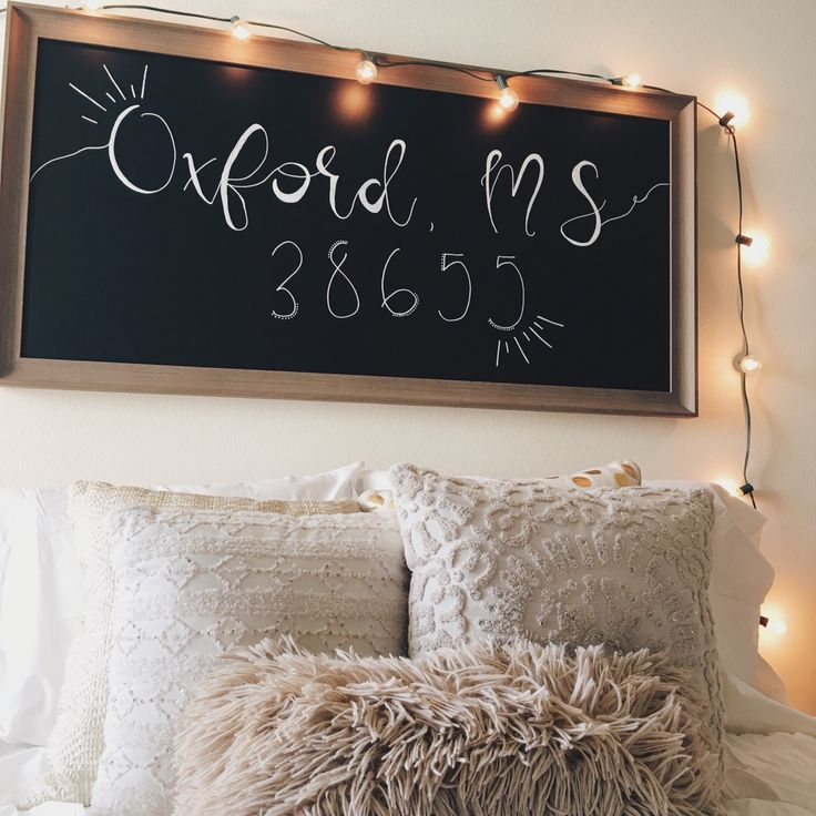 zip code chalk board above bed