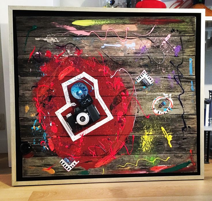 WHO SHOT THE CAMERA, 76 x 84, photo camera from the 70s on wood from a garden table, acrylic paint. Framed.