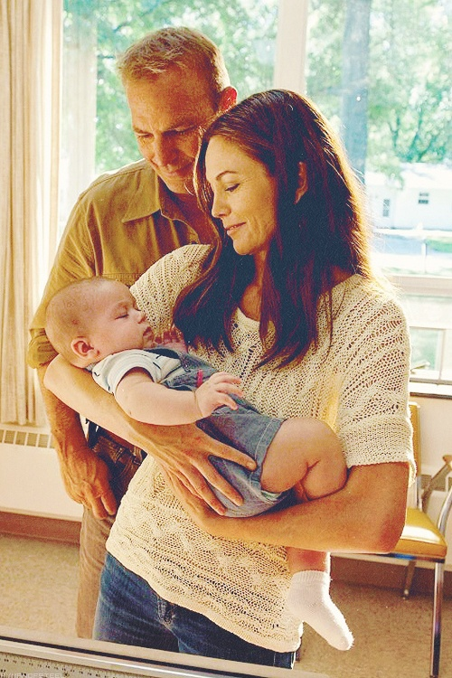 Jonathan and Martha Kent hold baby Clark from Superman Man of Steel {Wait wait wait, is this a deleted scene?}: