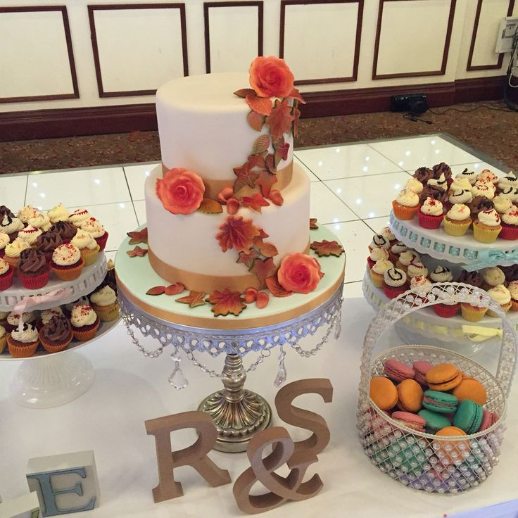 Autumnal theme wedding dessert table. Cake centrepiece decorated with fondant air-brushed leaves, roses & acorns. www.kellylou.com