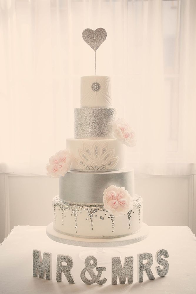 5 tier silver & pink art deco / vintage wedding cake - Image by Rocksalt Photography - Esme by Jenny Packham For A Traditional Wedding In Wales With A Navy And Silver Colour Scheme And Bridesmaids In Navy Dresses From BHS With Images From Rocksalt Photography