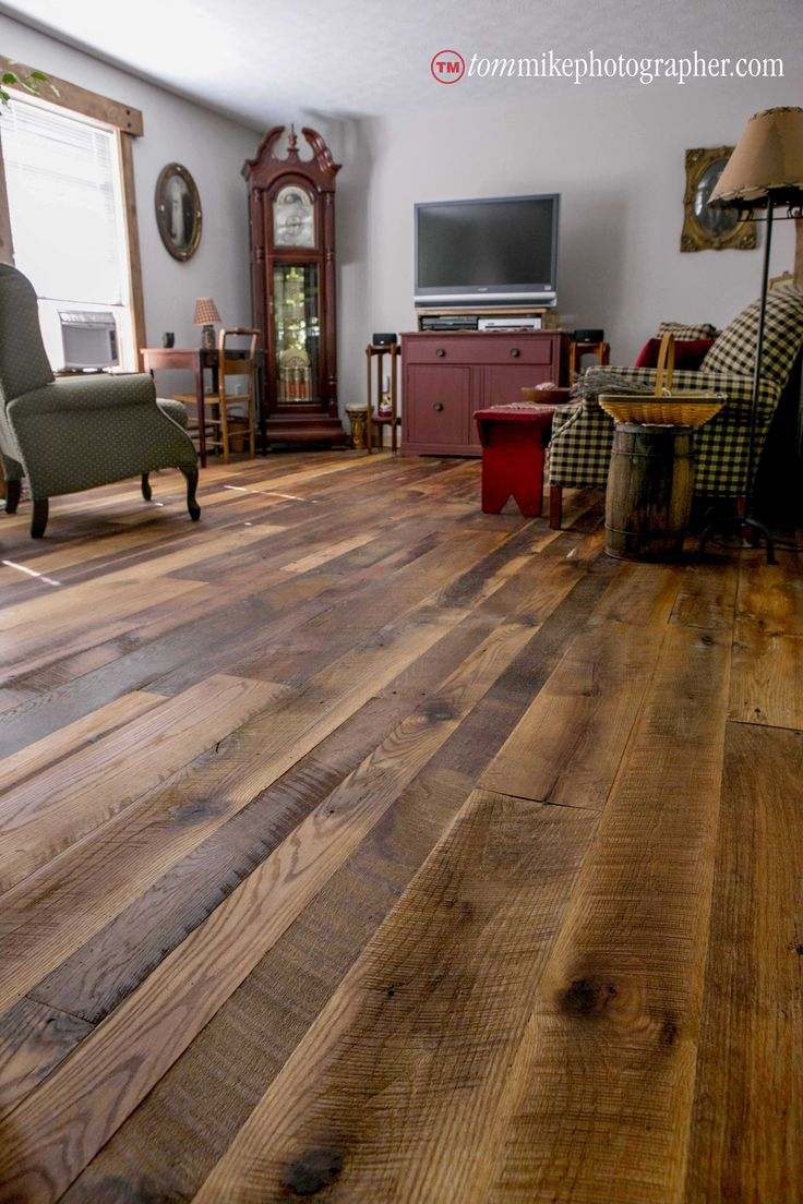 Mix of reclaimed red and white oak flooring high character lots of texture