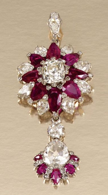 RUBY AND DIAMOND BROOCH/PENDANT, LATE 19TH CENTURY Designed as a cluster centring on a cushion-shaped diamond within surrounds of pear- shaped rubies and diamonds, further accented with rose-cut stones, suspending a ruby and diamond-set drop embellished with a principal pear-shaped diamond, detachable drop and pendant fitting, later detachable brooch fitting.