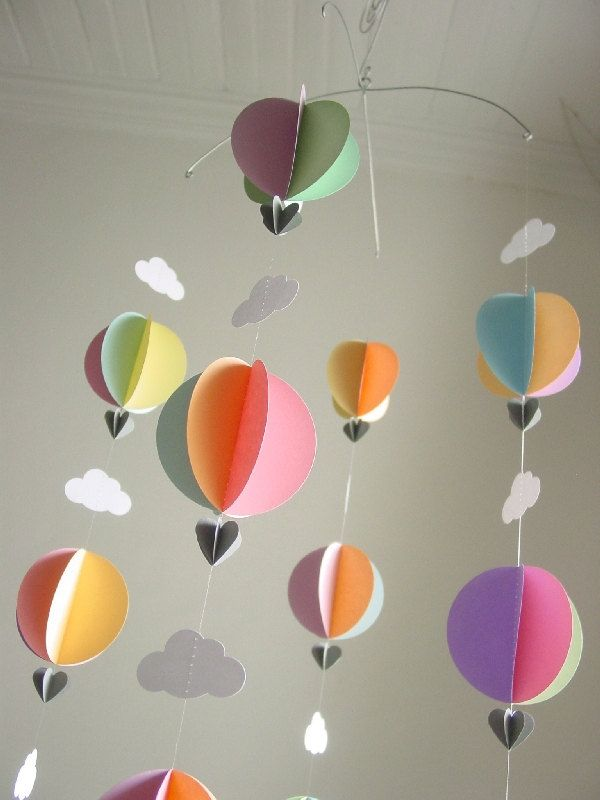 Mobile-Hot Air Balloons & Clouds-3D-Mobile-Crib Mobile-Baby-Nursery Decor-Kids Room-Children-Pastel Colours-Baby Shower Gift-Paper. $43.95, via Etsy.
