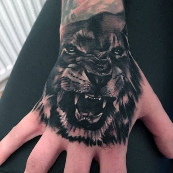 Top 51 Realistic Lion Tattoo Ideas 2020 Inspiration Guide Lion Hand Tattoo Men Hand Tattoos Lion Hand Tattoo
