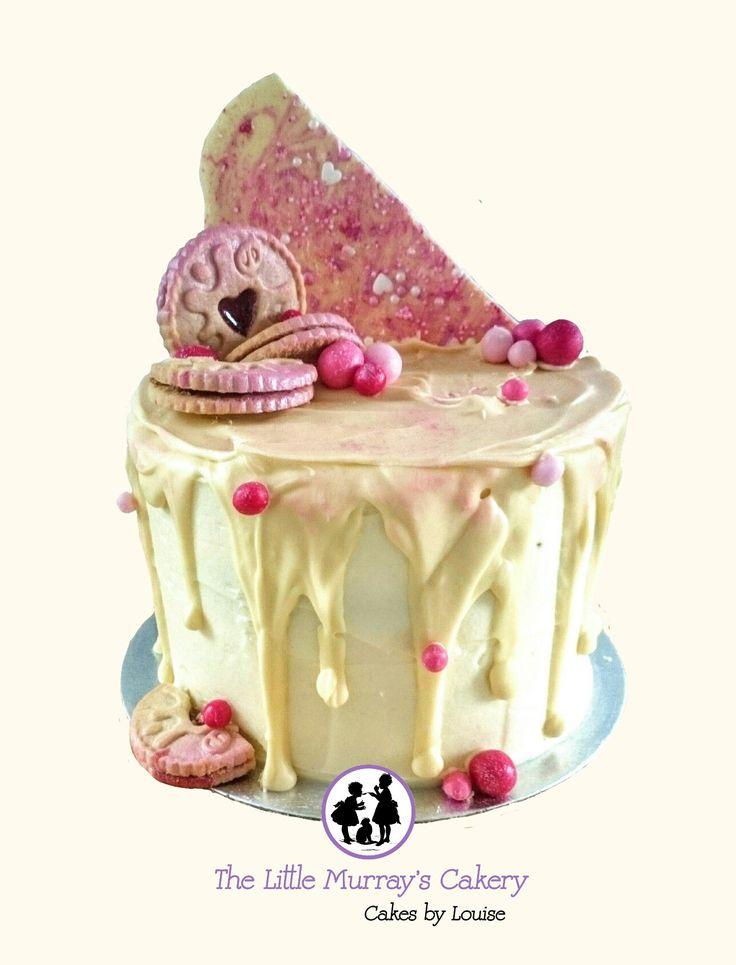 Jammie dodger drip cake. Vanilla sponge layered with vanilla buttercream and jam top with white chocolate ganache.