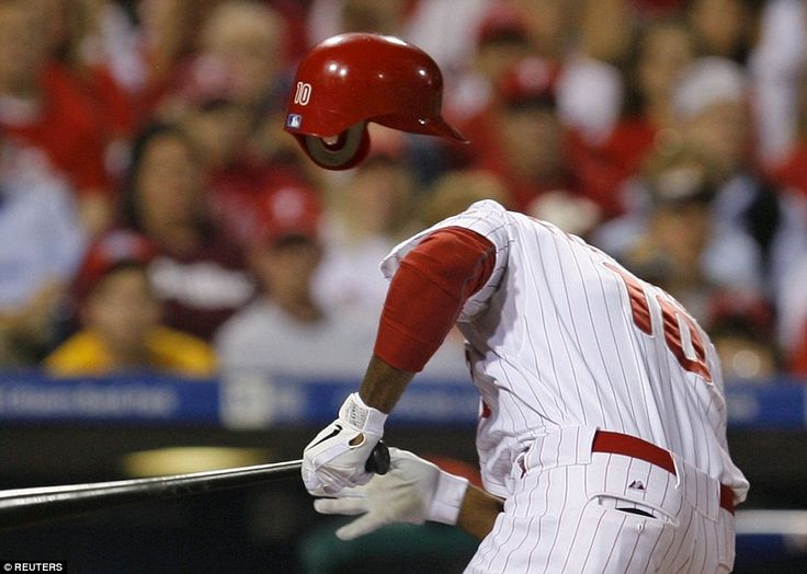 Where's his head? Philadelphia Phillies Ben Francisco reacts after being hit in the head w...