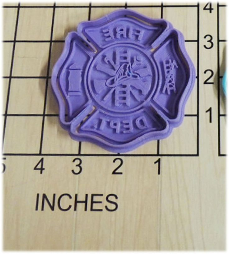 Fire Fighter Shield Cookie Cutter and Stamp #1078. Fire Fighter Shield Cookie Cutter and Stamp. This 3d printed plastic cutter makes the shape of a fire fighter shield. Some uses for this cutter are cookie dough, play doh, or fondant. The Stamp is made separately to accommodate any thickness of dough. Actual measurements can be seen in photo. Color of plastic will vary according to availability and may be different than shown. Please Note: Play Dough Sample Cookie is NOT INCLUDED.