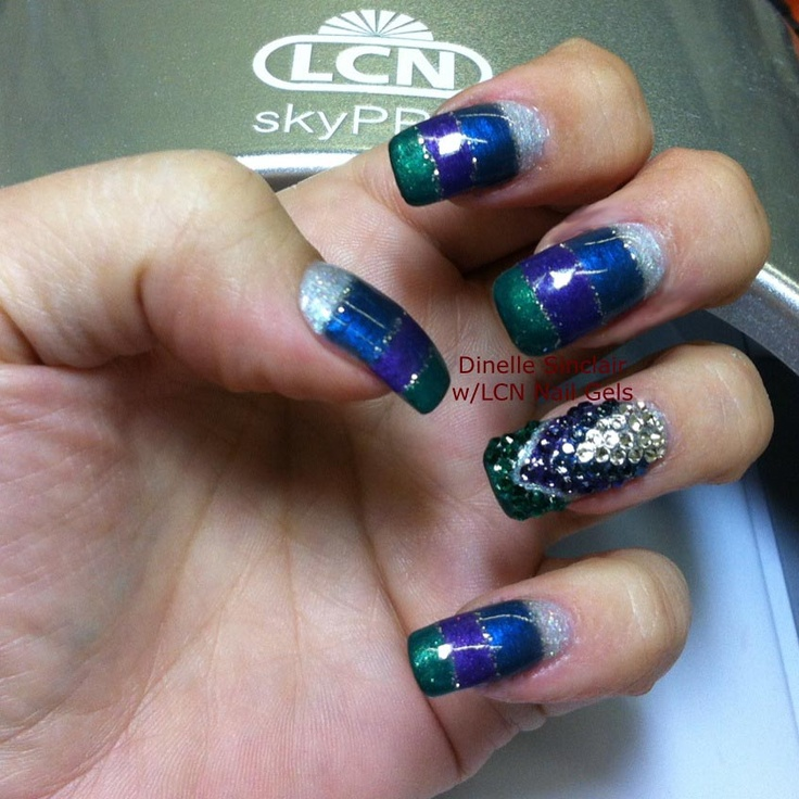 Used the New LCN Mystique Burlesque Color Gels w/ Light Glitter Silver Holo and Swarovski Rhinestones.