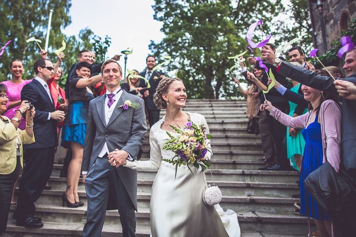 #Wedding #photography in #Helsinki, #Finland #couple #bride #groom #goodbye #waving #flower