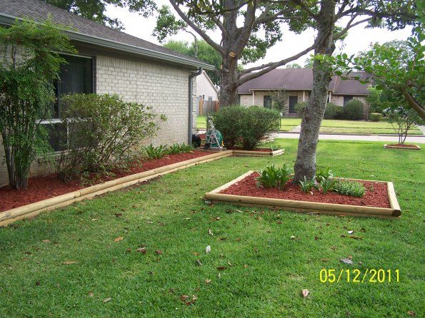 gallery custom beds with landscape timber border 595x446 Landscaping Timbers
