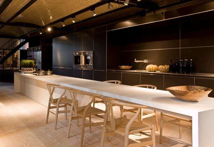 bulthaup. Like the hidden large cupboards, incorporating work space, and long island to include seating areak for long room