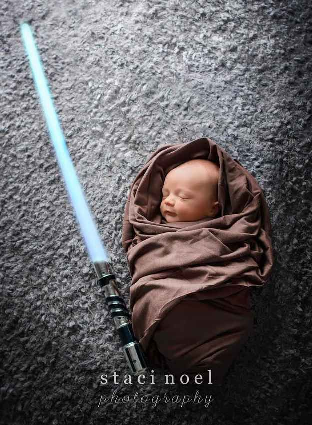 This Force-ful fellow: we already have a light saber! all we need is the baby