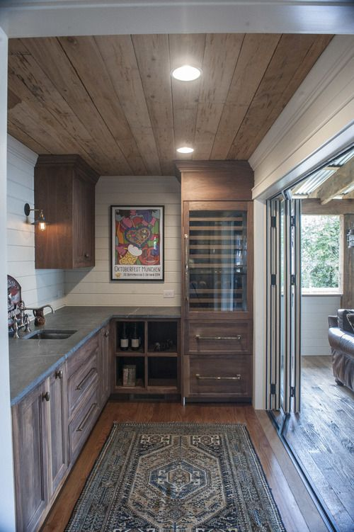 Wood Cabinets In Bar Area With Vintage Rug Planked