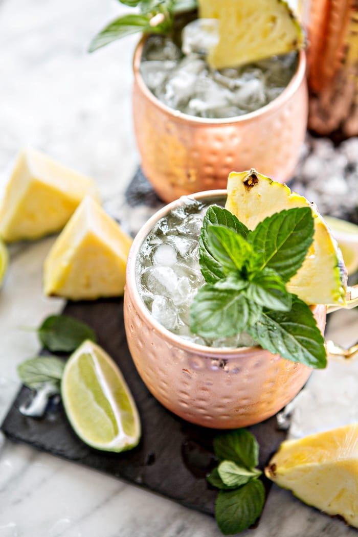 A classic Moscow Mule get a fruity twist with this recipe for Fresh Pineapple Mint Moscow Mules. @goodlifeeats www.goodlifeeats.com @bundabergbrewed BundabergBrews AD Msg21+