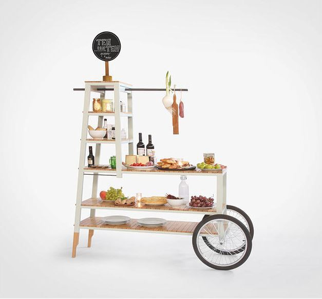 IL CARRELLO SPECIAL TWO WHEELS This story begins when The Ten Con Ten restaurant in Madrid asked us to design a new cart to present and cut the cheese. This cart is an evolution of 'Il Carrello' since it was customized for a specific necessity. It is produced in Oak wood and painted with a light blue finish.