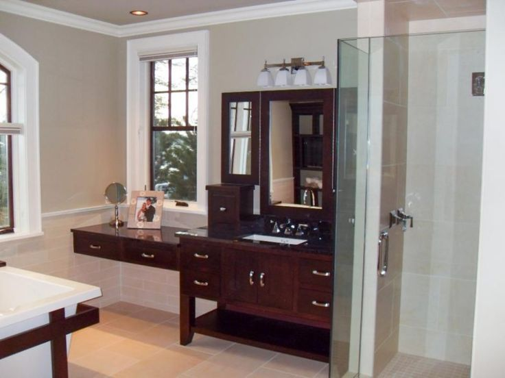 Bathroom: Furniture Style Vanity In Beige Transitional Bathroom. frameless shower door. glass door. classic wooden vanity. tile flooring.