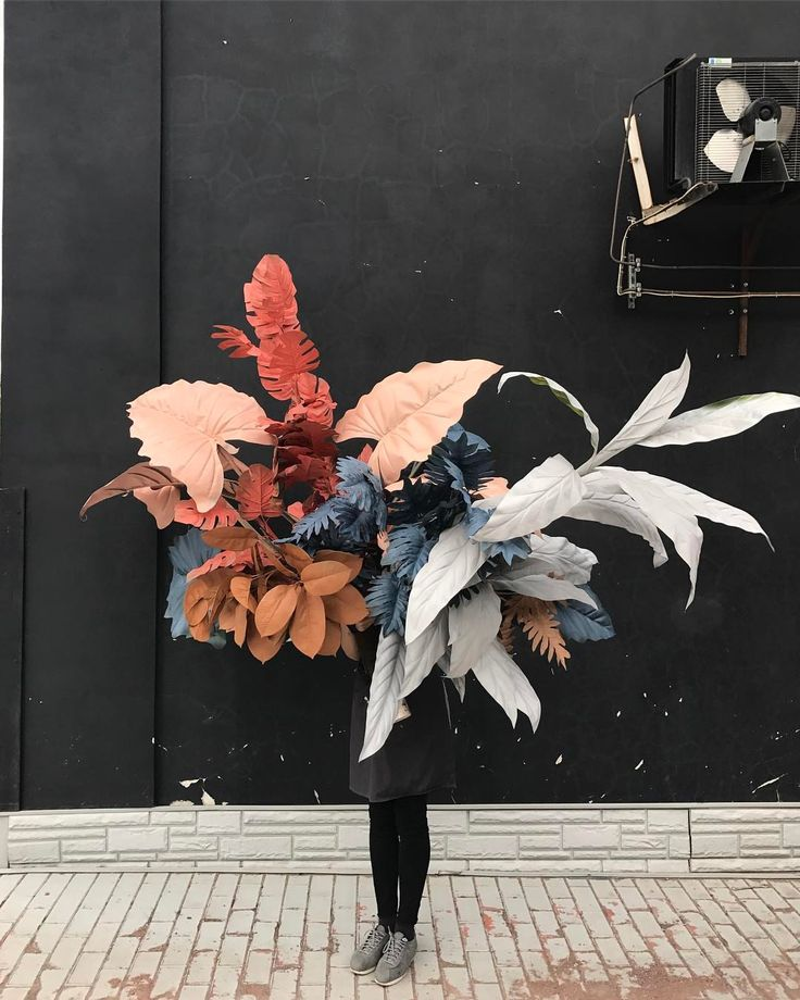 large spray painted leaves/ plants?