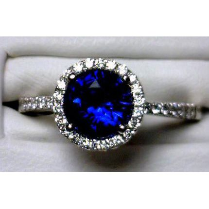 If it was an oval or cushion cut center stone, this would be perfect. <3  Sapphire center stone with diamond (would prefer white sapphire) micro pave halo and micro pave shoulders on a slender band.