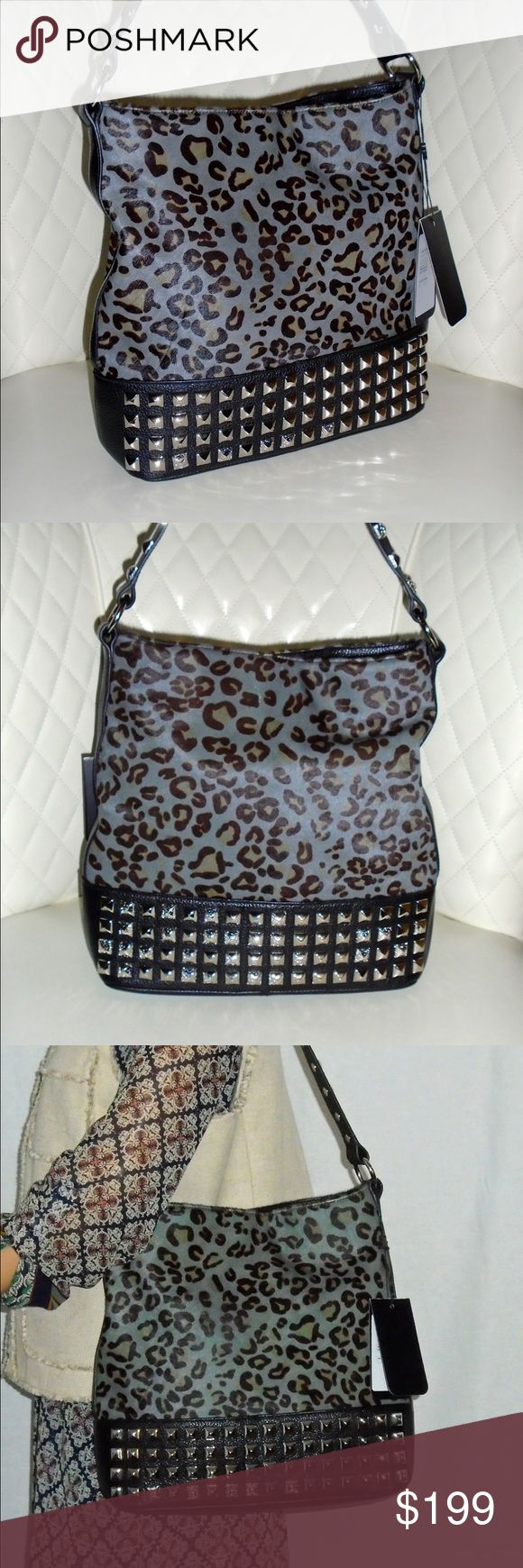 "BODHI Black/Gray Cheetah Print Studded Hobo Bag NWT BODHI Black/Gray Cheetah Print Calf Hair Studded Hobo Bag     100% Authentic Guaranteed!     STYLE #: B0778560AGBK   MSRP: $798 Before Tax   Brand New With Tags and Original Dust Bag    11"" L 12"" H x 4"" W   Single Handle w/11"" Strap Drop     Black/Gray Cheetah Print Calf Hair   Black Pebbled Leather   Silver Tone Hardware and Decorative Studding   Single Magnetic Snap Top Closure   LIned in Bodhi Signature Gray Cotton/Nylon Blend   1 Wall…"