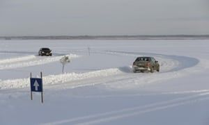 Cars drive on the ice road from Haapsalu to the Noarootsi peninsula, Estonia.