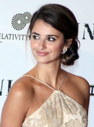 The Spanish actress Penélope Cruz takes the title Best Chignon with classic ballerina-style bun flattering the female body shape