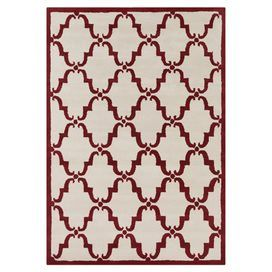 Handcrafted wool rug with a red lattice motif.  Product: RugConstruction Material: WoolColor: Red and whiteFeatures:  HandcraftedCotton backing Note: Please be aware that actual colors may vary from those shown on your screen. Accent rugs may also not show the entire pattern that the corresponding area rugs have.Cleaning and Care: Professional cleaning recommended