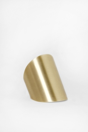 Gold matte cuff bracelet. One on each arm. and all black outfit