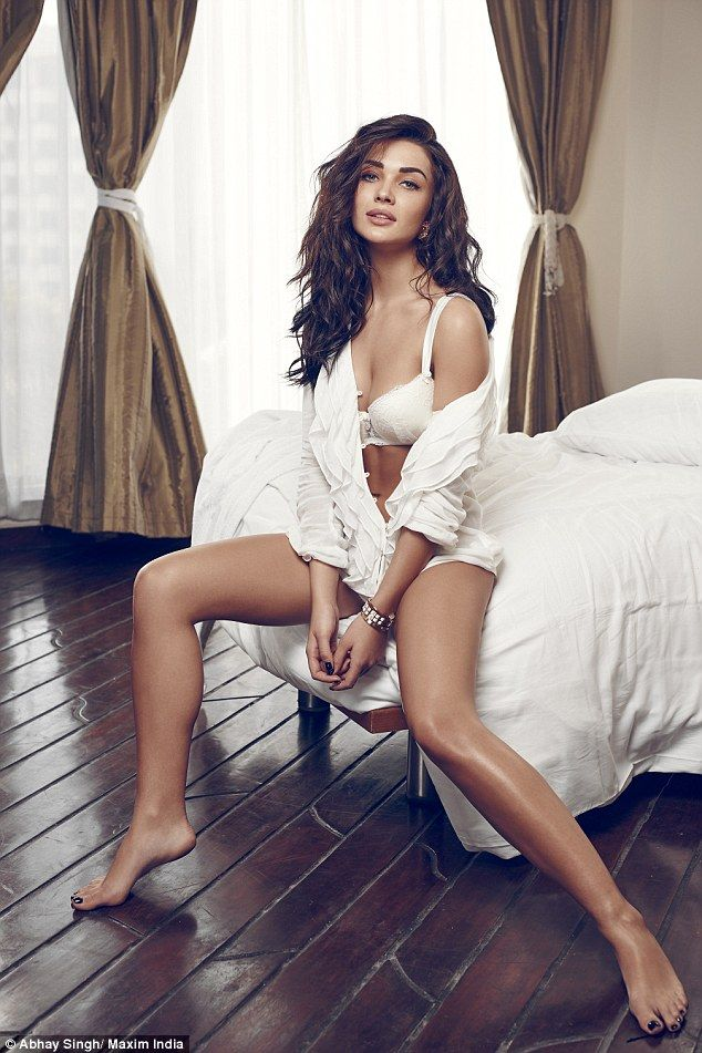 From Bollywood to bed! India's rising movie star Amy Jackson features in a racy lingerie shoot for Maxim India, teasingly titled 'In Bed With Amy Jackson'