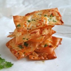 Quick, crunchy, and colorful, these parmesan wonton crackers are a great alternative to processed snack food.