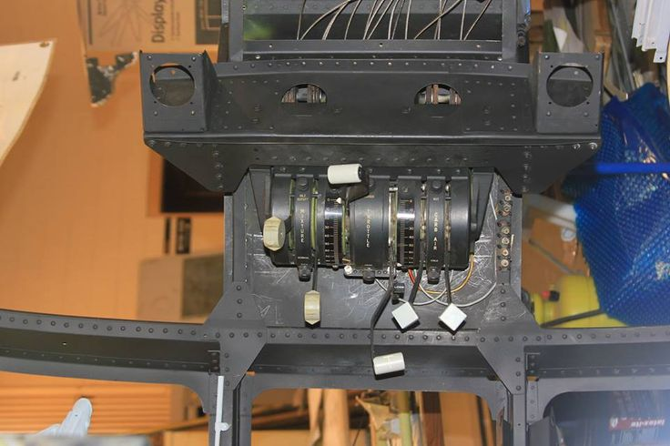 Engine control quadrant. Power, carb heat,  and mixture levers for the two piston engines are visible. The control cables will be routed aft over pulleys and terminated in bungee cords to give the feel of working controls. This quadrant controlled the two Pratt & Whitney R2800 16 cylinder piston engines that provided the 2100 hp each to the rotor.