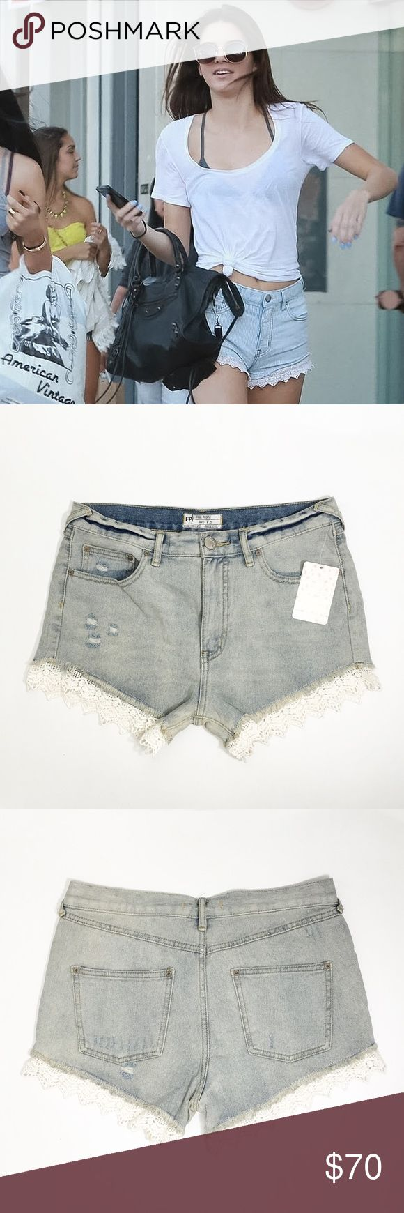 "Free People Light Denim Cutoff Lace Hem Shorts NO TRADES  As seen on Kendall Jenner, these light washed cut-off denim shorts crafted from fine cotton gets distressed, weathered & topped with a laced hem balancing between rugged & feminine.  Details: - Cotton - Machine wash - Imported - Waist: 31"" - Inseam: 3"" - Front Rise: 10.5"" - Back rise: 13.5"" - Thigh opening 22""  NOTES: - Pics 2-4 photographed by me. - Item's color WILL slightly vary from photos. - Paper tag is faintly damaged. Free…"